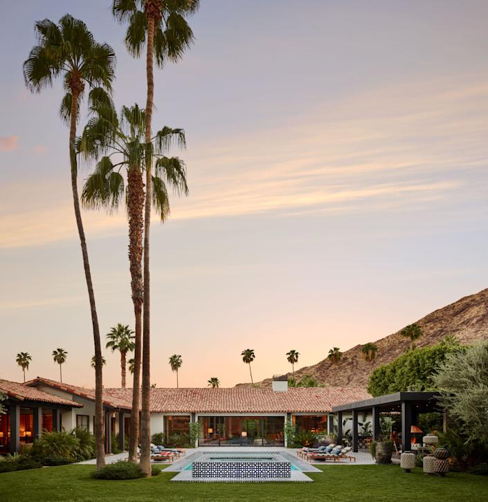 This 5,000-square-foot Spanish Mission Revival residence in Palm Springs, California, which sits at the foothills of the San Jacinto mountains, was renovated by siblings David and Suzie Lucas of Lucas Interior. Along with reorganizing the layout and connecting indoor and outdoor spaces in a more cohesive way, they opened up perimeter walls, added floor-to-ceiling glass pivot doors, and incorporated timber beams that felt original to the 1929 home. The finished design offers the homeowners, Jim John and Craig Hartzman, a youthful, breezy environment to relax and soak up the sun.
