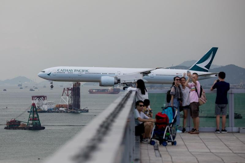 Analyst Who Cut Cathay to Sell Says He Faces Huge Pressure
