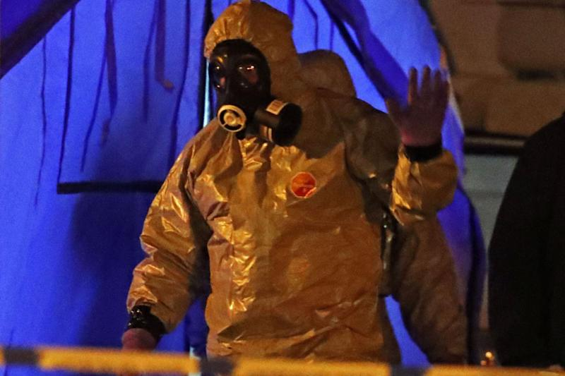 An investigator in protective gear after the alleged poisoning of Russian spy Sergei Skripal (PA)