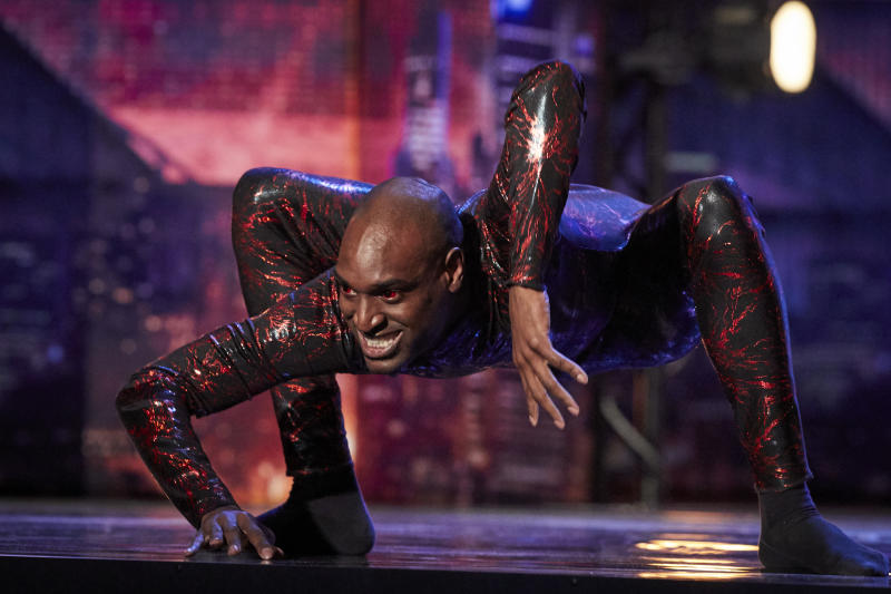 Contortionist Troy James bends his body in a red jumpsuit accessorised with red contact lenses during his Australia's Got Talent Audition on Sunday August 4th