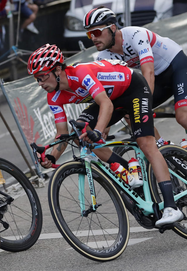 Race leader Primoz Roglic, left, rides with the pack in the Spanish capital during the La Vuelta cycling race in Madrid, Spain, Sunday, Sept. 15, 2019. (AP Photo/Manu Fernandez)