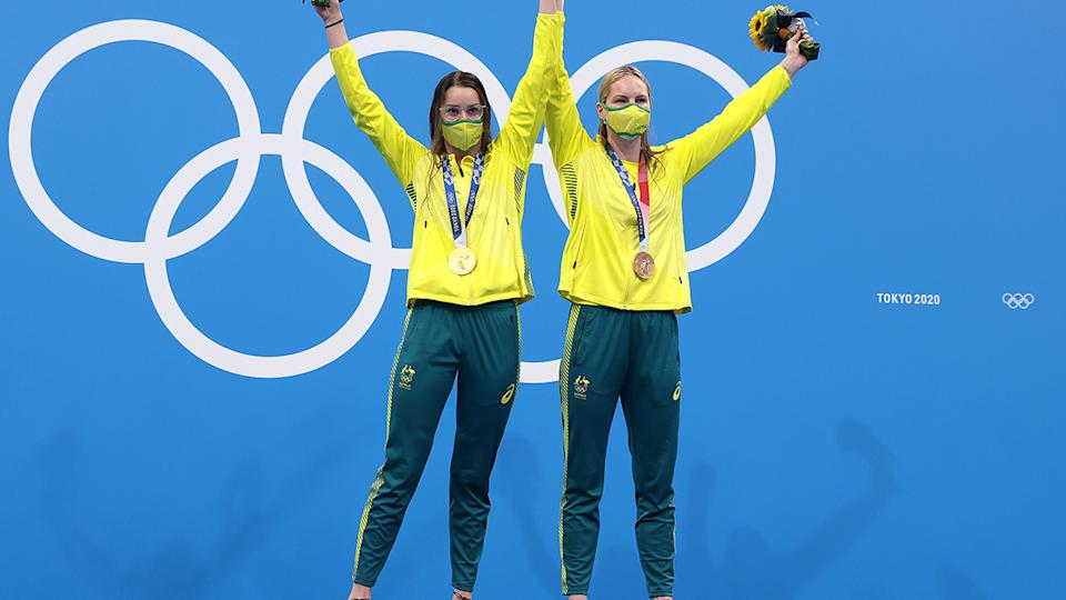Kaylee McKeown and Emily Seebohm, pictured here on the podium during the medal ceremony.