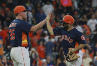 Houston Astros' pitcher Will Harris celebrates with teammate Jose Altuve after defeating the Los Angeles Angels in a baseball game Sunday, Sept. 23, 2018, in Houston. (AP Photo/Richard Carson)