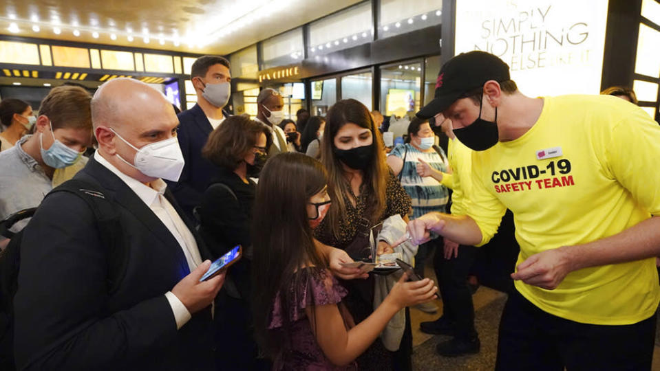"""Theatergoers show proof of vaccination before a performance of """"The Lion King"""" on Broadway, at the Minskoff Theatre, on Tuesday, Sept. 14, 2021, in New York. (Photo by Charles Sykes/Invision/AP) - Credit: Charles Sykes/Invision/AP"""