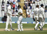 New Zealand captain Tom Latham, second left, shakes hands with England's Zak Crawley, left, after their win on the fourth day of the second cricket test match between England and New Zealand at Edgbaston in Birmingham, England, Sunday, June 13, 2021. (AP Photo/Rui Vieira)