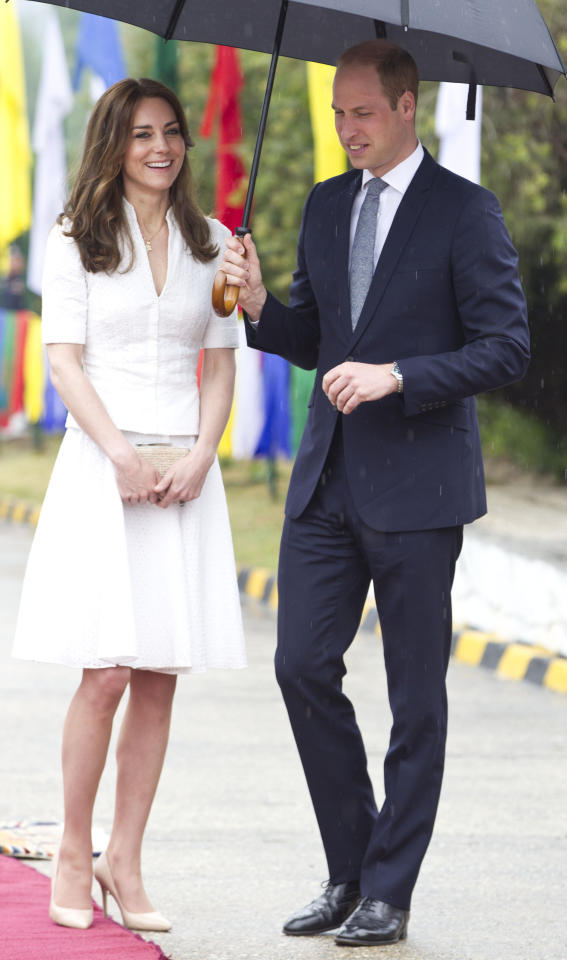 <p>Snapped at Paro Airport in Bhutan, before leaving to jet back to India, the Duchess wore a crisp, white ensemble and her trusty, nude Rupert Sanderson heels.<i> [Photo: PA Images]</i></p>