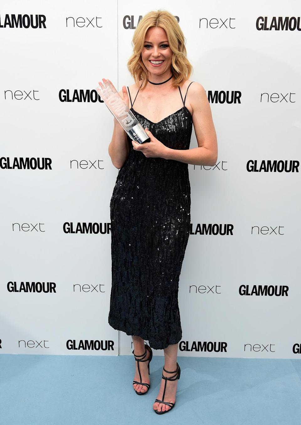 """<p>The """"Hunger Games"""" actress opted for a sequin covered LBD, which showed off her toned arms.<i> [Photo: PA Images]</i></p>"""