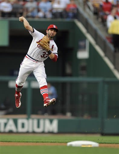 St. Louis Cardinals second baseman Daniel Descalso leaps and throws but is unable to throw out Milwaukee Brewers' Cody Ransom during the third inning of a baseball game Saturday, Aug. 4, 2012, in St. Louis. (AP Photo/Jeff Curry)