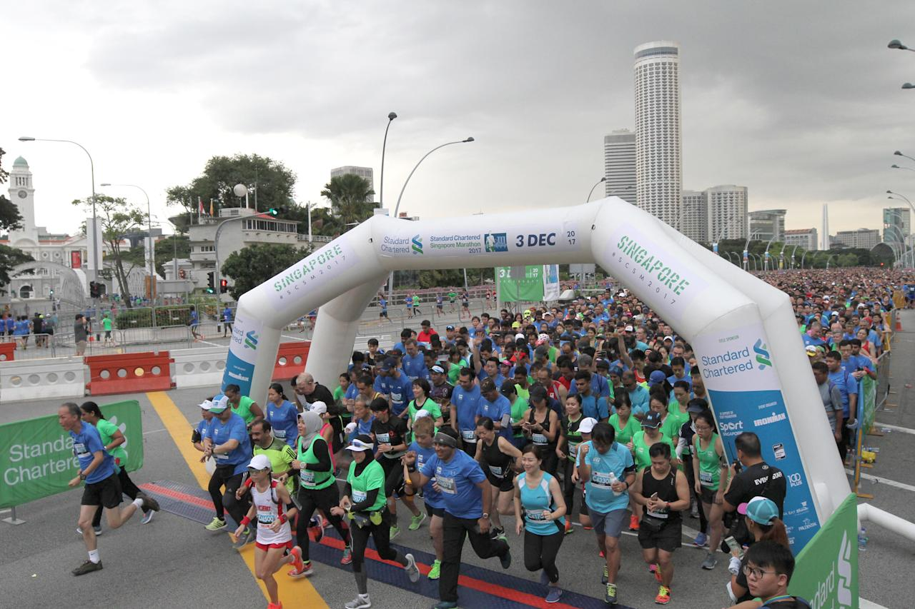 <p>Runners of the Standard Chartered Singapore Marathon 2017 10km race flagged off at Esplanade Drive on the morning of 3 December 2017. Photo: Standard Chartered Singapore Marathon 2017 </p>