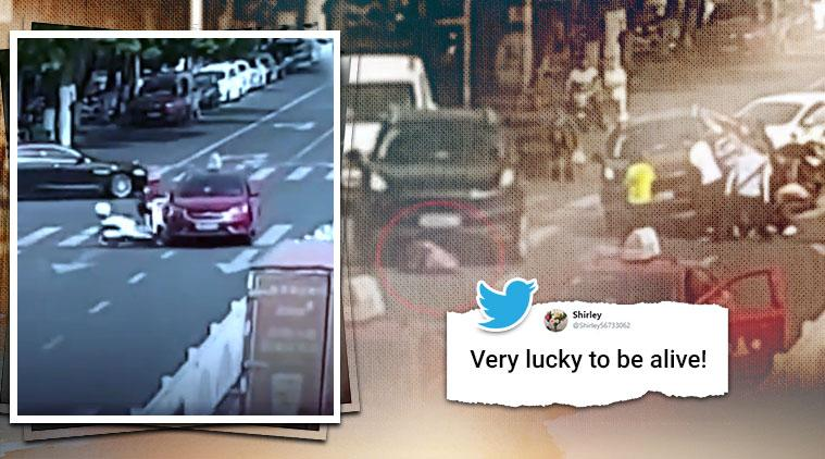 woman in china run over by suv, woman china viral video, woman run over by suv survives, trending