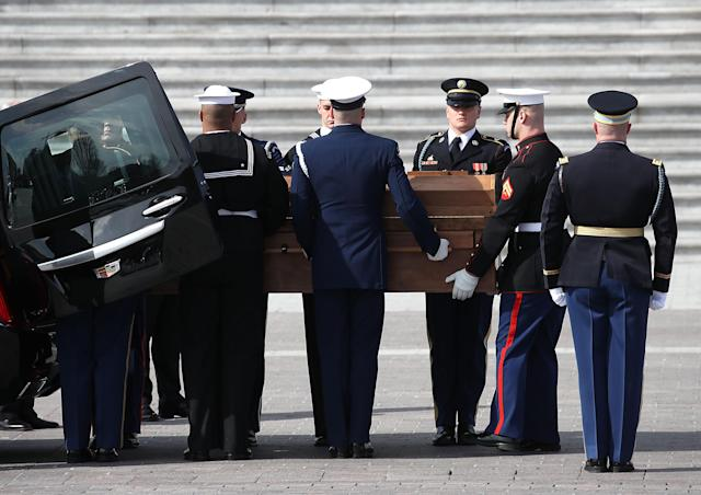 <p>A joint U.S. Military honor guard carries a casket containing the remains of evangelist Rev. Billy Graham at the U.S. Capitol, on Feb. 28, 2018 in Washington. (Photo: Mark Wilson/Getty Images) </p>