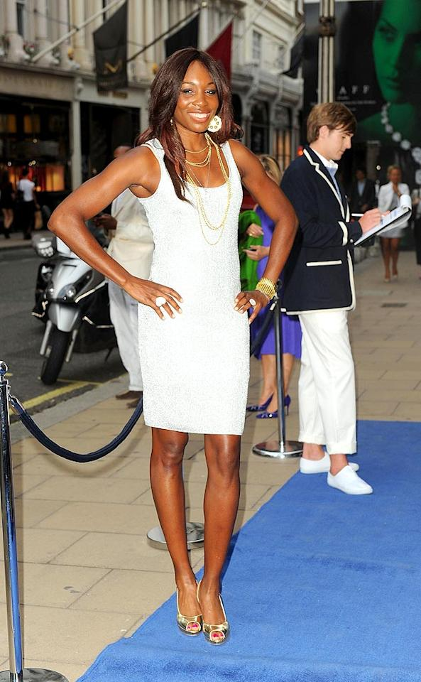 """Venus Williams has been quite fashionable on court as of late, but the tennis ace also manages to dress well when not crushing her opponents. At a Wimbledon party, hosted by Ralph Lauren, the elder Williams sister looked smashing in a simple yet stylish textured frock, metallic peep-toes, and gold accessories. Ferdaus Shamim/<a href=""""http://www.wireimage.com"""" target=""""new"""">WireImage.com</a> - June 17, 2010"""