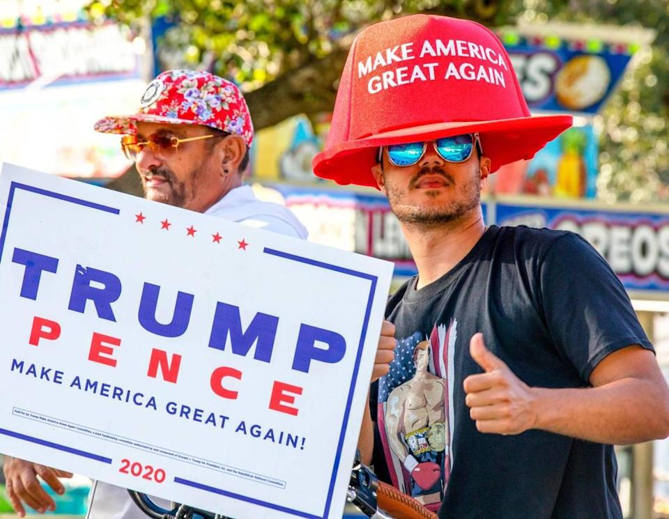 A Trump supporter shows a thumbs-up after an anti-socialism car caravan at Tamiami Park near Miami-Dade County Fair grounds in Sweetwater, Florida, on Sunday, Oct. 18, 2020.