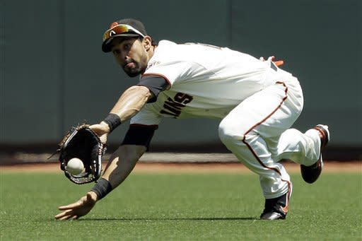 San Francisco Giants center fielder Angel Pagan cannot catch San Diego Padres' Will Venable's two-run double during the fourth inning of a baseball game in San Francisco, Wednesday, July 25, 2012. (AP Photo/Jeff Chiu)