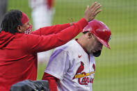 St. Louis Cardinals' Paul Goldschmidt, right, is congratulated by teammate Carlos Martinez after hitting a solo home run during the first inning of a baseball game against the Washington Nationals Tuesday, April 13, 2021, in St. Louis. (AP Photo/Jeff Roberson)