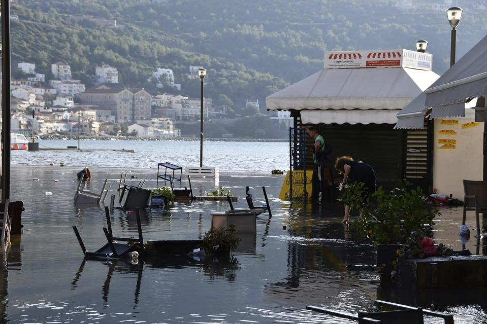 Seawater covers a square after an earthquake at the port of Vathi on the eastern Aegean island of Samos, Greece, Friday, Oct. 30, 2020. A strong earthquake struck in the Aegean Sea between the Turkish coast and the Greek island of Samos as the magnitude 6.6 earthquake was centered in the Aegean at a depth of 16.5 kilometers, or 10.3 miles.(AP Photo/Michael Svarnias)