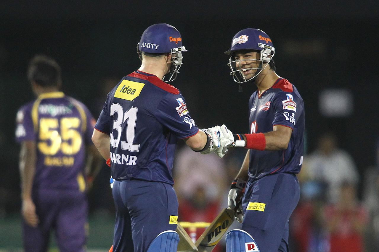 David Warner of Delhi Daredevils is congratulated by Unmukt Chand of Delhi Daredevils for reaching his fifty during match 44 of the Pepsi Indian Premier League between The Delhi Daredevils and the Kolkata Knight Riders held at the Chhattisgarh International Cricket Stadium in Raipur on the 1st May 2013..Photo by Shaun Roy-IPL-SPORTZPICS .. .Use of this image is subject to the terms and conditions as outlined by the BCCI. These terms can be found by following this link:..https://ec.yimg.com/ec?url=http%3a%2f%2fwww.sportzpics.co.za%2fimage%2fI0000SoRagM2cIEc&t=1495633425&sig=ZwcfHRkCJzVsdnGYBkkkgQ--~C
