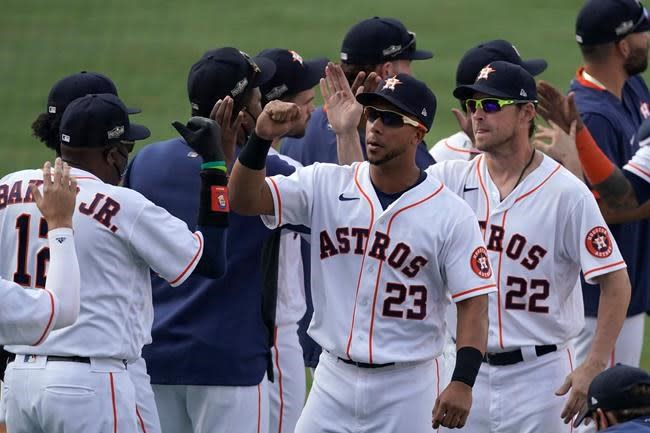Correa powers Astros past A's 11-6 to win ALDS