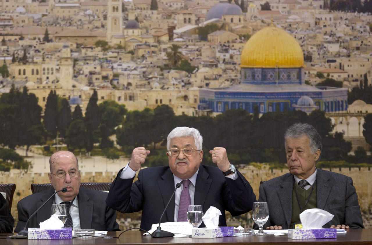 <p> FILE - In this Jan. 14, 2018 file photo, Palestinian President Mahmoud Abbas, center, speaks during a meeting with the Palestinian Central Council, at his headquarters in the West Bank city of Ramallah. A series of recent health scares have raised new concerns about octogenarian Abbas, reviving anxiety about a potentially chaotic, and even bloody, succession battle that is bound to further weaken the Palestinian cause. In the latest sign of Abbas' health troubles, officials and medical sources say a cardiologist has moved into the presidential compound in Ramallah to monitor the longtime leader. (AP Photo/Majdi Mohammed, File) </p>