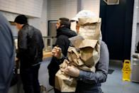 A worker carries takeout orders for pickup at the at a Chopt Creative Salad Co., location in New York