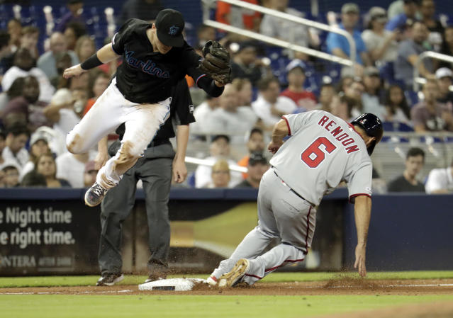 Washington Nationals' Anthony Rendon (6) steals third ahead of the throw to Miami Marlins third baseman Brian Anderson, left, during the sixth inning of a baseball game, Friday, April 19, 2019, in Miami. (AP Photo/Lynne Sladky)