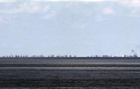 The alleged on-going land reclamation of China at Subi reef is seen from Pagasa island (Thitu Island) in the Spratlys group of islands in the South China Sea, west of Palawan, Philippines, May 11, 2015.  REUTERS/Ritchie B. Tongo/Pool/File Photo