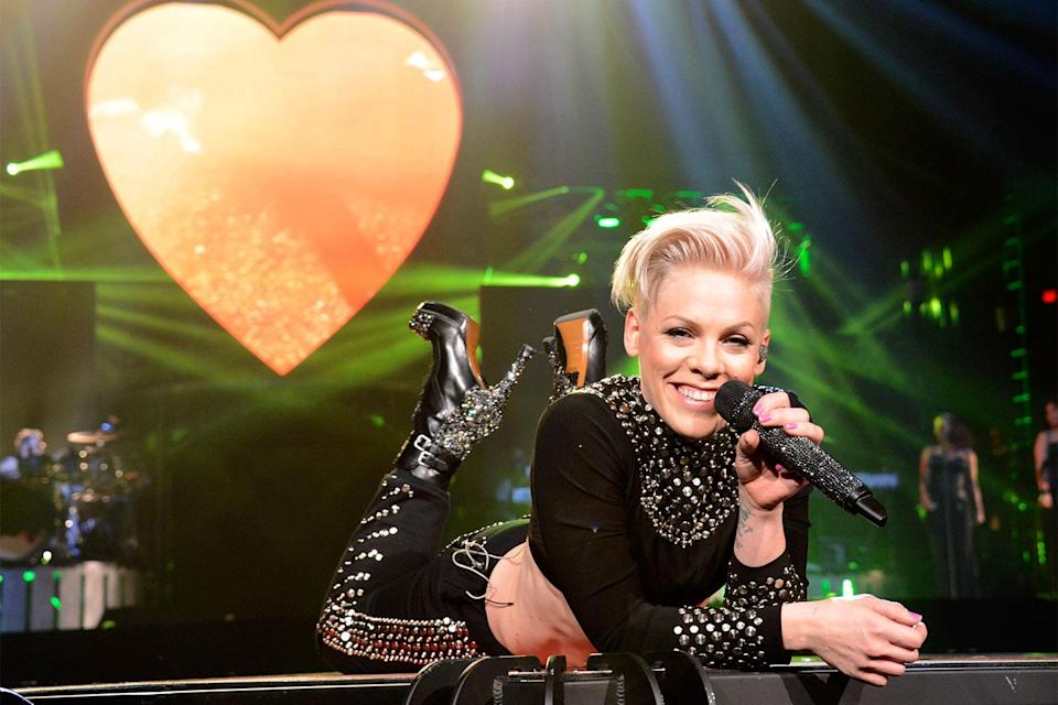 """<p>In 2013, Pink was showing no signs of slowing down, releasing another hit album, <em>The Truth About Love</em>, which included songs like """"Blow Me (One Last Kiss), """"Just Give Me a Reason,"""" """"Try"""" and """"True Love."""" Her tour was the third highest-grossing of that year. </p> <p>And she didn't stop there: She was named Woman of the Year by <em>Billboard</em>, and she managed to flex her acting muscle in the film <em>Thanks for Sharing </em>alongside Gwyneth Paltrow. </p>"""