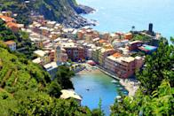 """<p>We stop intermittently among the lush foliage to catch our breath. Our efforts aren't without reward though. Once we hit the first round, we turn to face the sea and are greeted by the most picturesque view I've seen in my life: Vernazza laying below us.<br></p><p><i>(Photo: <a href=""""http://www.dtravelsround.com/"""" rel=""""nofollow noopener"""" target=""""_blank"""" data-ylk=""""slk:D Travels Round"""" class=""""link rapid-noclick-resp"""">D Travels Round</a>)</i></p><p><b><i>Related: <a href=""""https://www.yahoo.com/travel/9-gorgeous-seaside-towns-in-italy-85668662097.html"""" data-ylk=""""slk:Gorgeous Seaside Towns in Italy You Have to Visit This Summer;outcm:mb_qualified_link;_E:mb_qualified_link;ct:story;"""" class=""""link rapid-noclick-resp yahoo-link"""">Gorgeous Seaside Towns in Italy You Have to Visit This Summer</a></i></b><br></p>"""