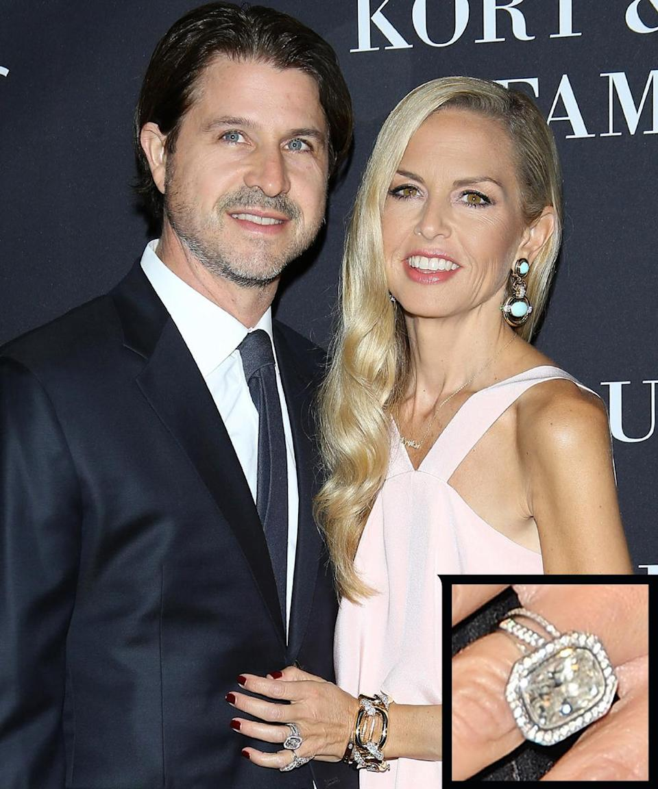 <p>The designer and Rodger Berman married in 1996 and since then her engagement ring has seen some updates. The latest huge ring she's been sporting looks like a cushion-cut, bezel-set diamond in a halo setting.</p>