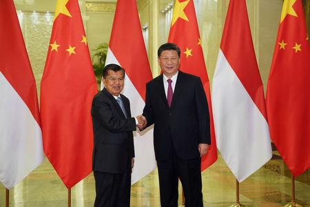 Chinese President Xi Jinping shakes hands with Indonesia's Vice President Jusuf Kalla before the bilateral meeting of the Second Belt and Road Forum at the Great Hall of the People, in Beijing, China  April 25, 2019. Andrea Verdelli/Pool via REUTERS  *** Local Caption *** BEIJING, CHINA - APRIL 25: Egypt President Abdel Fattah El-Sisi talks to Chinese President Xi Jinping (not pictured) during a bilateral meeting of the Second Belt and Road Forum at the Great Hall of the People on April 25, 2019 in Beijing, China. (Photo by