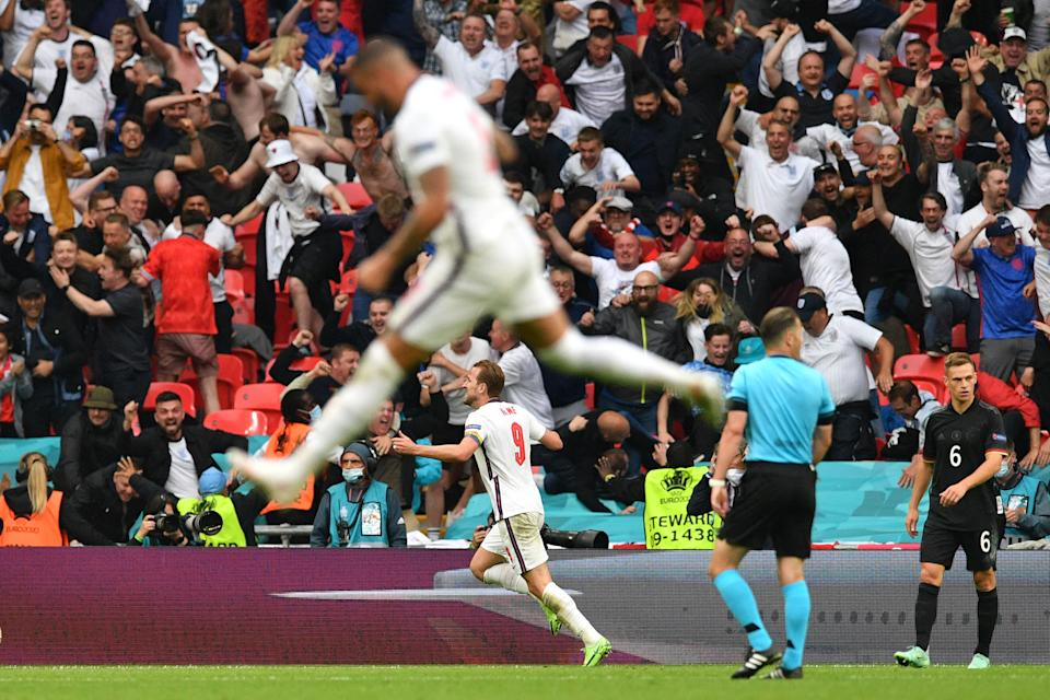 TOPSHOT - England's forward Harry Kane celebrates with the fans after scoring the second goal during the UEFA EURO 2020 round of 16 football match between England and Germany at Wembley Stadium in London on June 29, 2021. (Photo by JUSTIN TALLIS / POOL / AFP) (Photo by JUSTIN TALLIS/POOL/AFP via Getty Images)