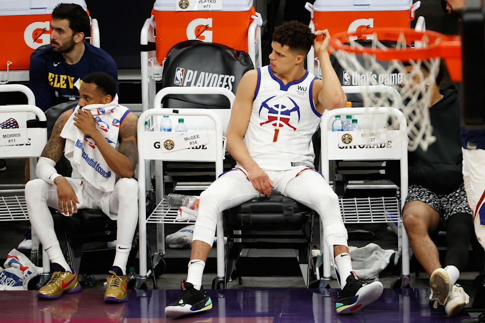 Michael Porter Jr. and Monte Morris look dejected while sitting on the bench.