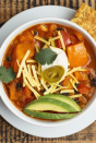 """<p>Give your chili a whole new twist with a seasonal favorite: pumpkin! This one is full of peppers, beans, hot sauce, and cilantro for a cozy stew that can't be beat. Top with Greek yogurt for some tang, and your stomach will thank you.</p><p><a href=""""https://www.prevention.com/food-nutrition/recipes/a20525961/southwestern-bean-and-pumpkin-chili/"""" rel=""""nofollow noopener"""" target=""""_blank"""" data-ylk=""""slk:Get the recipe »"""" class=""""link rapid-noclick-resp""""><strong><em>Get the recipe »</em></strong></a></p>"""