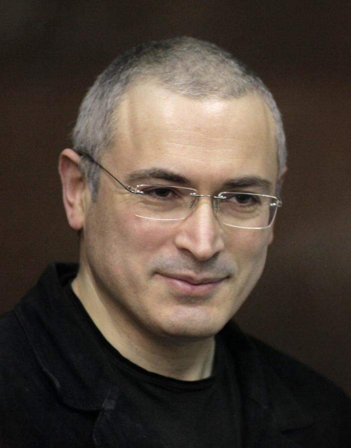 FILE In this Thursday, Dec. 30, 2010 file photo Mikhail Khodorkovsky stands behind glass at a court room in Moscow, Russia. Russian President Vladimir Putin said Thursday Dec. 19, 2013 after his annual news conference that Khodorkovsky will pardon jailed tycoon Mikhail Khodorkovsky. (AP Photo/Alexander Zemlianichenko Jr)