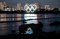 Olympic officials insist the postponed Tokyo Games will go ahead despite the risks