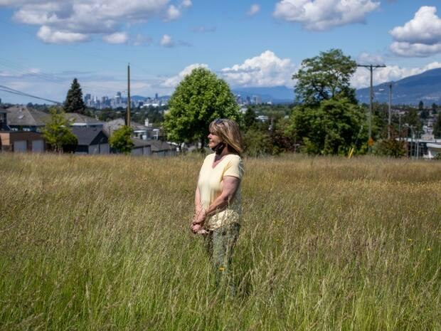 Megan Watson is pictured in a park where a pollinator pilot project is taking place in East Vancouver.  (Ben Nelms/CBC - image credit)