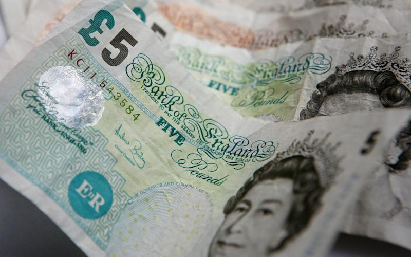 Paper fivers will cease to be legal tender on Friday and are being replaced with new polymer £5 notes, which are more durable and less easy to fake. - PA