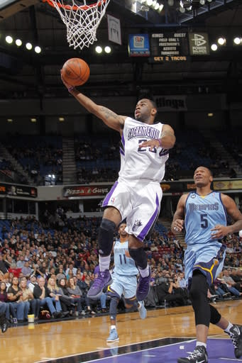 SACRAMENTO, CA - MARCH 20: Marcus Thornton #23 of the Sacramento Kings takes the ball to the basket against Marreese Speights #5 of the Memphis Grizzlies on March 20, 2012 at Power Balance Pavilion in Sacramento, California. (Photo by Rocky Widner/NBAE via Getty Images)