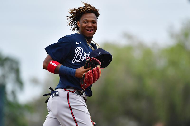 SARASOTA, FLORIDA - FEBRUARY 26: Ronald Acuna Jr. #13 of the Atlanta Braves runs to the outfield during the middle of the third inning of a spring training baseball game against the Baltimore Orioles at Ed Smith Stadium on February 26, 2020 in Sarasota, Florida. (Photo by Julio Aguilar/Getty Images)