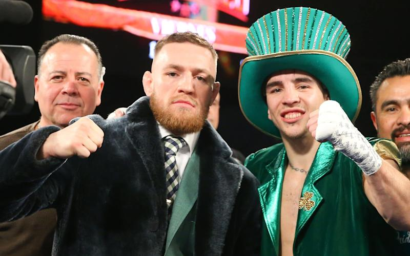Michael Conlan, right, celebrates his defeat of Tim Ibarra with Conor McGregor - 2017 Getty Images