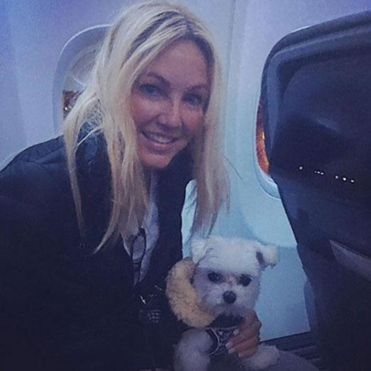 The last photo she shared before her arrest was one of her with her puppy on her lap while they were on their way to Boston. Source: Instagram/heatherlocklear