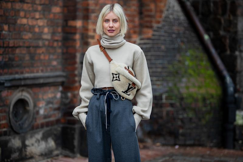BERLIN, GERMANY - JANUARY 14: Lisa Hahnbueck is seen wearing cropped turtleneck Orse & Iris, grey paperbag pants Odeeh, Louis Vuitton shearling bumbag during the Berlin Fashion Week Autumn/Winter 2020 on January 14, 2020 in Berlin, Germany. (Photo by Christian Vierig/Getty Images)