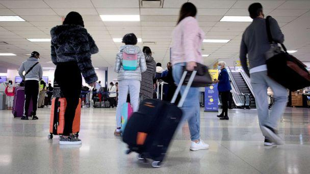 PHOTO: Travelers arrive to check in for flights ahead of the Thanksgiving holiday at Newark International Airport in Newark, N.J., Nov. 25, 2020. (Mike Segar/Reuters)