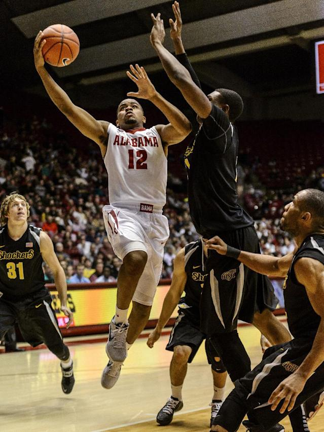 Alabama Guard Trevor Releford (12) goes to the basket against Wichita State during an NCAA college basketball game Tuesday, Dec. 17, 2013, in Tuscaloosa, Ala. (AP Photo/AL.com, Vasha Hunt)