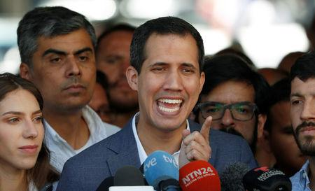 Venezuelan opposition leader Juan Guaido, who many nations have recognized as the country's rightful interim ruler, talks to the media after attending a religious event in Caracas, Venezuela February 10, 2019. REUTERS/Carlos Garcia Rawlins