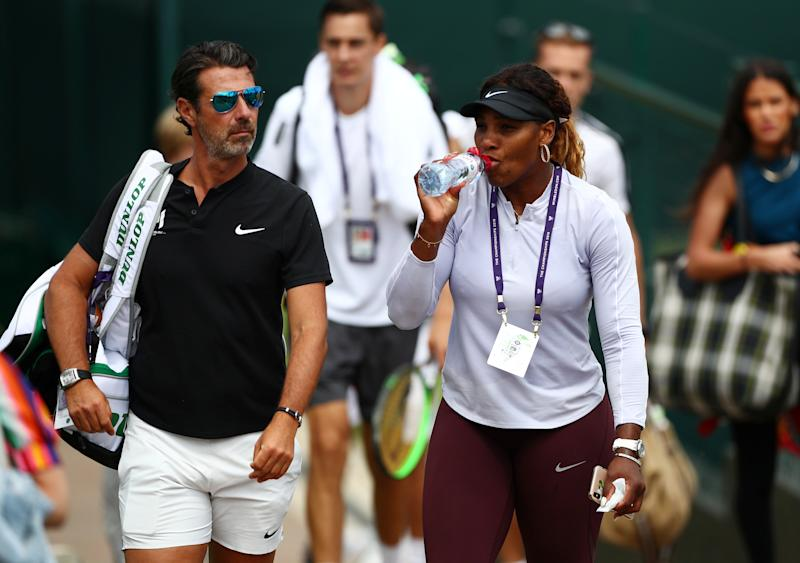Serena Williams (pictured right) walking with her coach, Patrick Mouratoglou (pictured left), before practice.