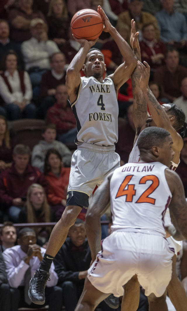 Wake Forest guard Torry Johnson (4) shoots over Virginia Tech guard Ty Outlaw (42) during the first half of an NCAA college basketball game Saturday, Jan. 19, 2019, in Blacksburg, Va. (AP Photo/Don Petersen)