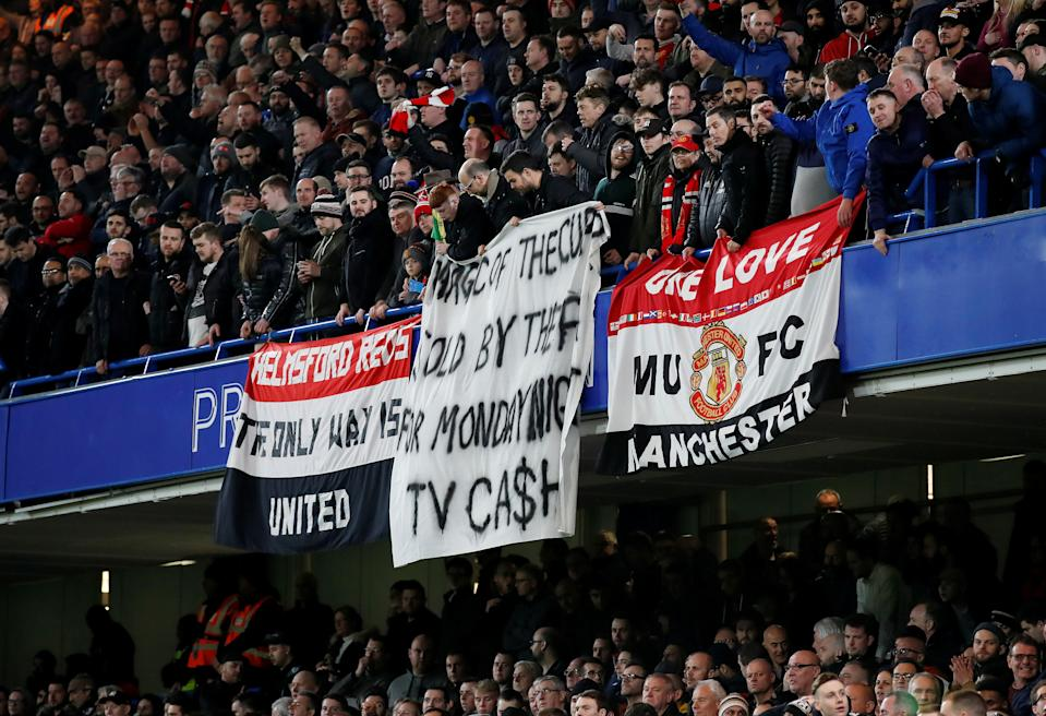 Soccer Football - FA Cup Fifth Round - Chelsea v Manchester United - Stamford Bridge, London, Britain - February 18, 2019  Manchester United fans display a banner in reference to the match being scheduled for a Monday  REUTERS/David Klein