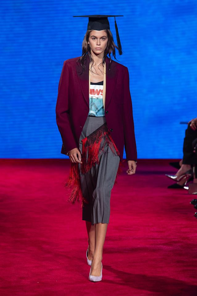 <p>Creative Director Raf Simons drew inspiration for his spring 2019 collection from classic Hollywood films like <em>Jaws </em>and <em>The Graduate</em>. Guests were treated to a floor-to-ceiling projection of water while models walked the blood-red carpeted runway. They had the ends of their hair dipped in water, to create the illusion they just came out of the ocean. As for the clothes, the <em>Jaws</em> poster was stamped with the Calvin Klein logo and printed on tanks and tees. Models walked down the runway in graduation gowns and caps. See if you can pick out references to the movies in the collection, ahead.</p>