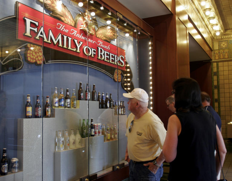 FILE -- In this July 14, 2008 file photo, visitors taking the Anheuser-Busch brewery tour view beers made by the company in St. Louis. The Busch family sold Anheuser-Busch to the Belgian brewer InBev in 2008, but the massive brewery remains an integral part of St. Louis, making some of the nation's best-selling brews, including Budweiser and Bud Light. (AP Photo/Jeff Roberson, FILE)